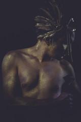 mythology golden bodypaint, man with gold helmet, ancient warrio