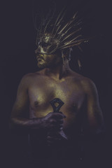 masculine, golden bodypaint, man with gold helmet, ancient warri