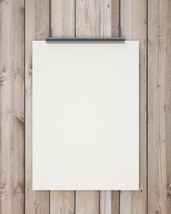 blank white hanging poster on vertical wooden planks wall