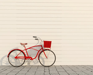 red retro bicycle with basket in front of the white wall