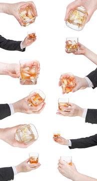 set of whiskey with ice glass in hand