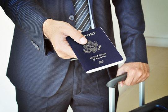 Businessman giving U.S. passport