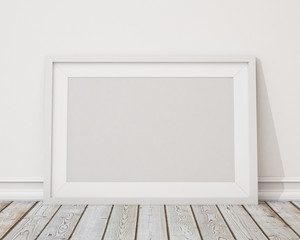 blank white horizontal picture frame on the wall