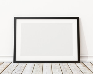 blank black horizontal picture frame on the wall and the floor