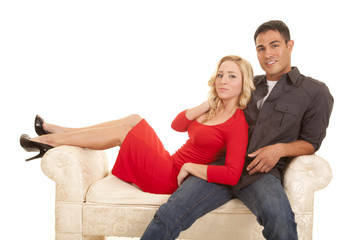 couple sitting on couch red dress and heels