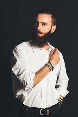 Young handsome man in white shirt on black background