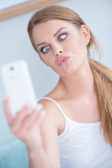 Young woman pulling a face for selfie