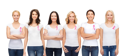 smiling women with pink cancer awareness ribbons
