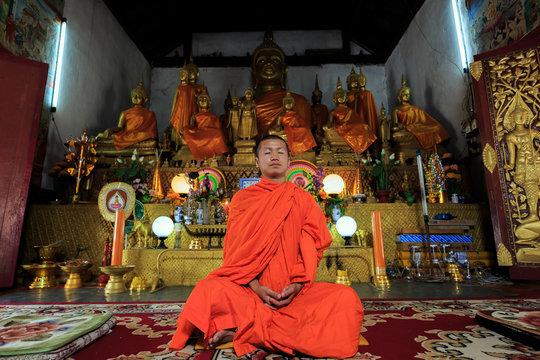 Young Buddhist Monk meditating