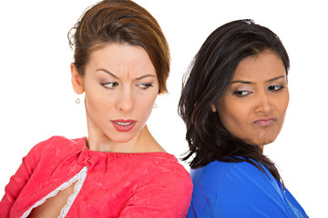 Unhappy, angry girls, back to back on white background