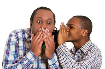 Guy whispering into man's ear, men spread rumor
