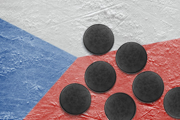 Czech flag and puck on the ice