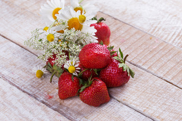 Fresh organic strawberry and wild flowers
