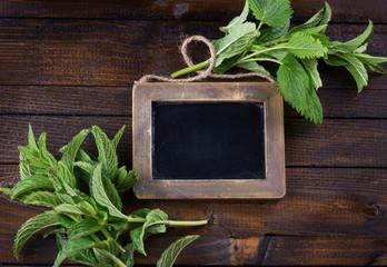 Empty blackboard and herbs