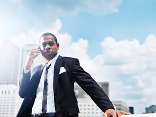 african businessman with smartphone