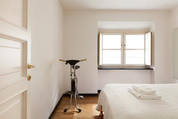interior bedroom wtîth exercise bike