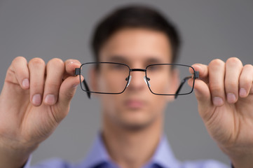 man wearing glasses to improve vision.