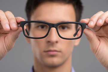 man trying glasses to improve vision.