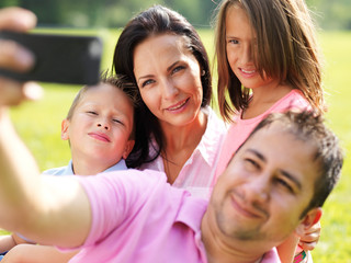 father taking selfie with family
