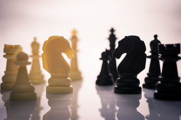 two side of chess face together business concept of competition