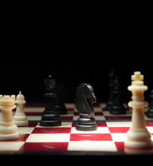 Chess character on black background for strategy business concep
