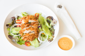 Fried Chicken salad with tomatoes,  Cucumber and Onion.