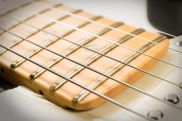 close up guitar and strings with shallow depth of field