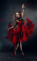 Flamenco dancing woman in red dress