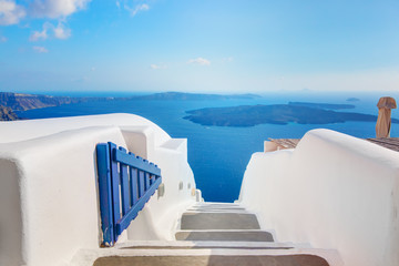 Santorini, Greece. Open blue door. Aegean sea view and Caldera