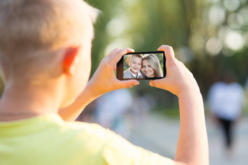 boy photographed on a smartphone