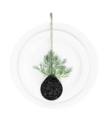 Spoon with black caviar on plate isolated on white