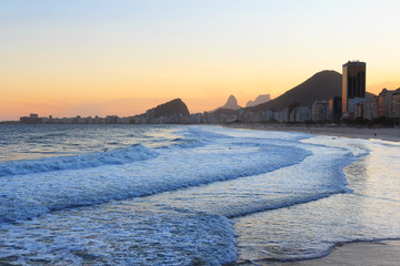 Copacabana beach, mountain Vidigal, Pedra da Gavea, sea in sunse