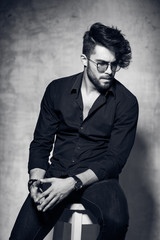 sexy fashion man model dressed casual wearing glasses posing
