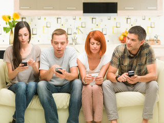 friends playing on smartphones