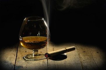 Cognac and cigar. Glass of brandy