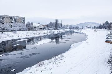 winter river under ice