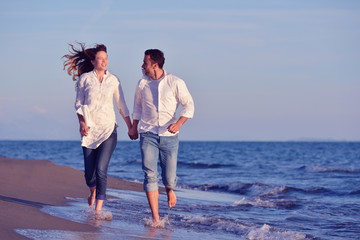 young couple  on beach have fun