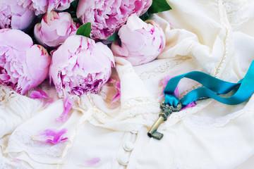 Key with peony flowers