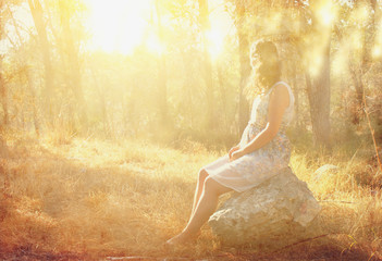 surreal blurred background of young woman sitting on the tsone i