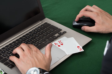Businessman With Cards Using Laptop
