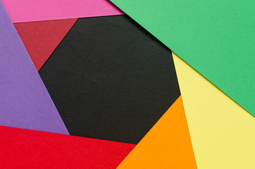 colorful paper sheets forming an aperture like shape