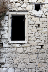 Dark arched window in a stone wall background