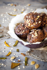 muffins with pumpkin chocolate and oat flakes on bowl