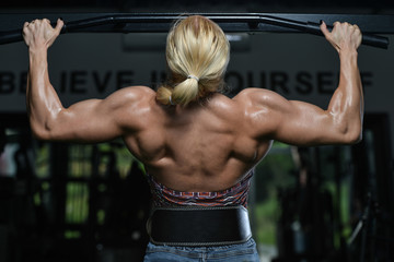 Young Female Doing Back Exercises In The Gym