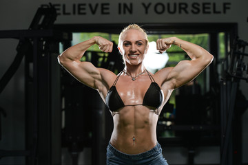 Woman Bodybuilder Flexing Muscles