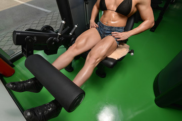 Woman Bodybuilder Doing Exercise For Legs