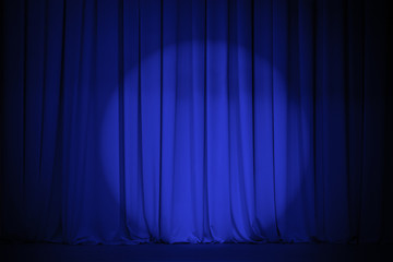 theatre blue curtain with light spot
