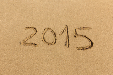 2015 happy new year - handwritten on sand