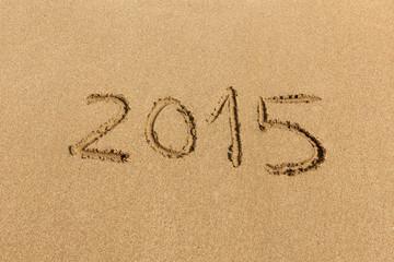 2015 happy new year - handwritten on sand