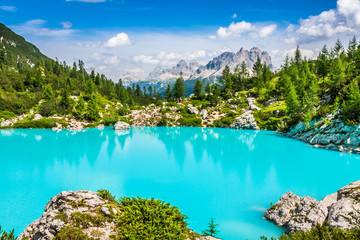 Turquoise Sorapis Lake  in Cortina d'Ampezzo, with Dolomite Moun